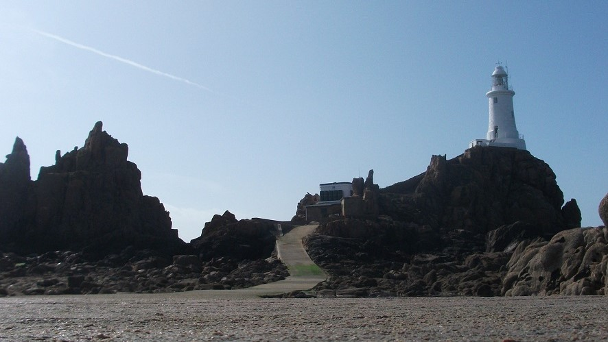 Corbiere Lighthouse against sunny skies