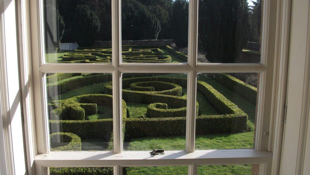 Hedged Gardens through Chatelherault County Park Hunting Lodge windows